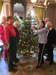 Members of the Community Garden Club hard at work decorating the Doric House parlor!